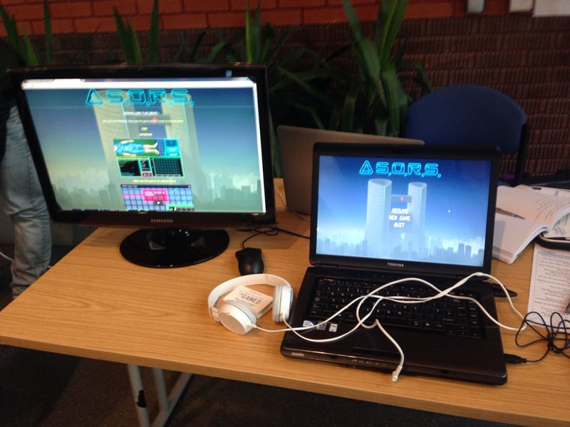 The updated demo ready for play testers, alongside a monitor showing the game website.